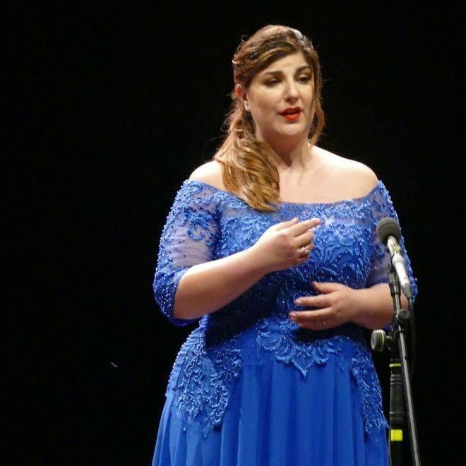 The soprano Marta Mari sings during the concert in honor of Magda Olivero at the Coccia Theater in Novara.